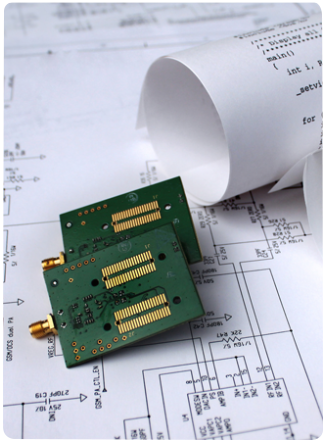 Prototype PCBs on information sheets