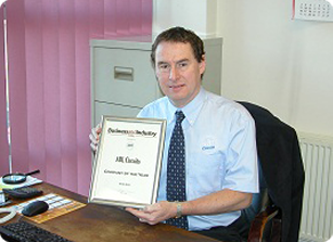Mark proudly showing certificate for ABL Circuits Printed Circuit Boards